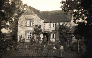 The farmhouse at Low Farm, with Ada Woodruff at the front door