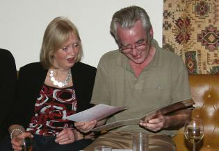 """John and Elaine admiring their """"Good Luck"""" card"""
